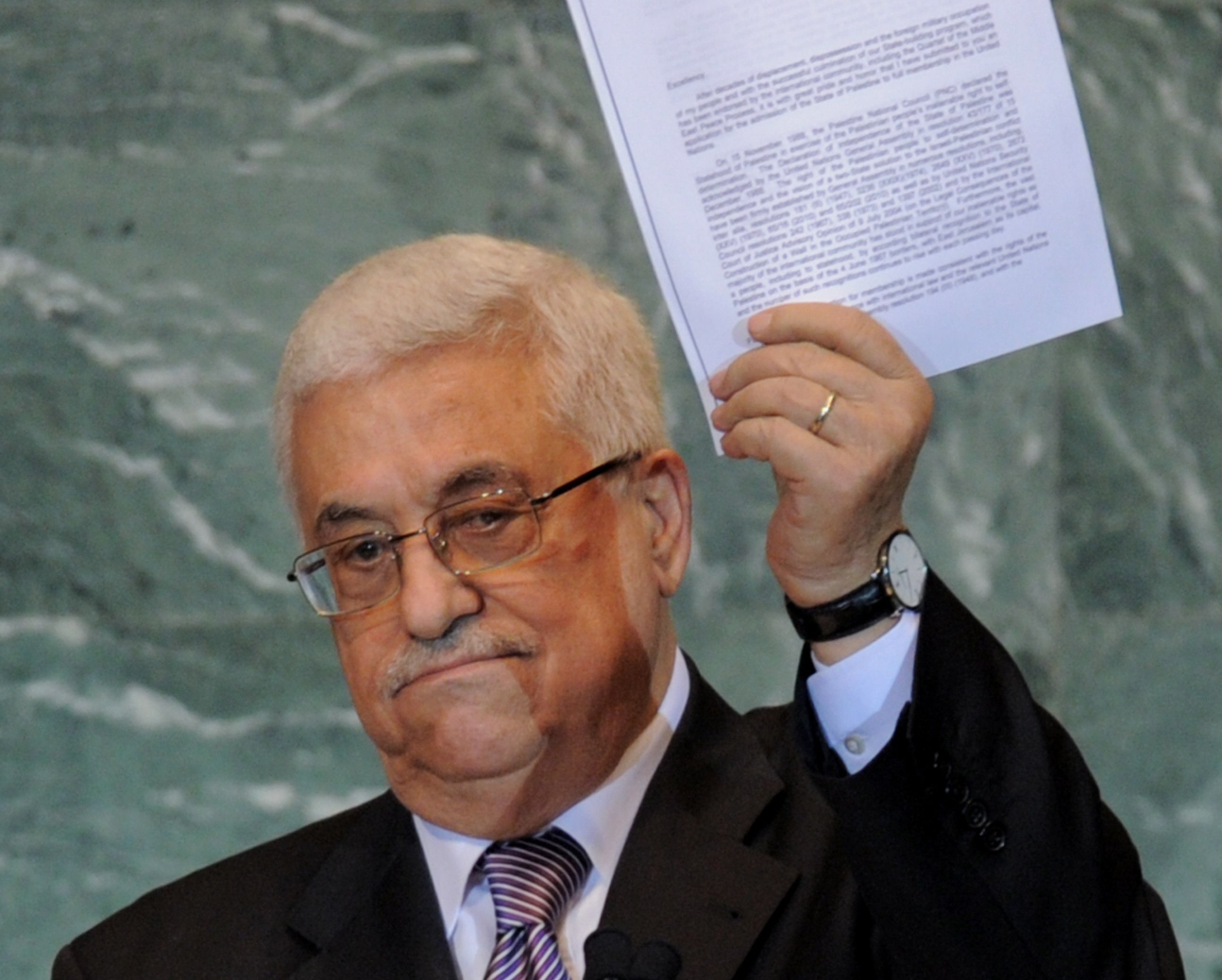 mahmoud abbas president of the palestinian authority holds a copy of the letter requesting palestinian statehood as he speaks during the united nations general assembly september 23 2011 at un headquarters in new york photo afp