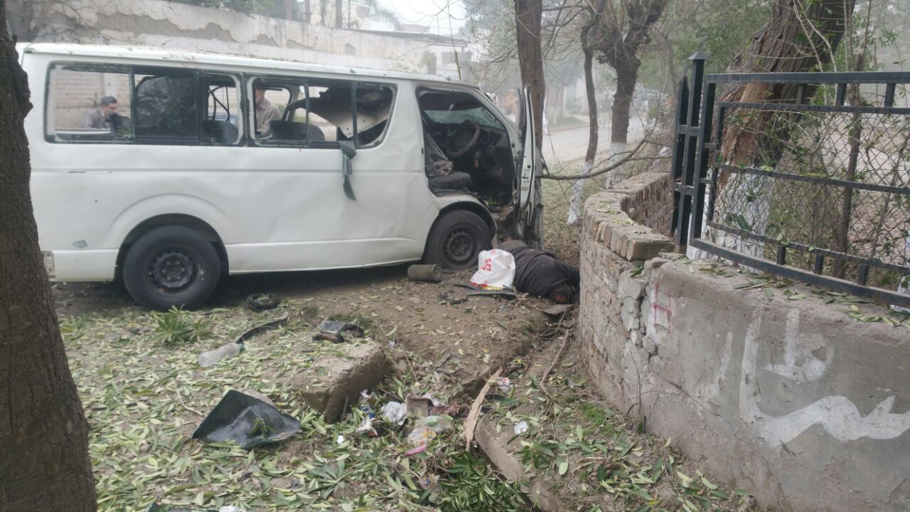 the blast targeted a government van a 5597 while it was on its way to judges colony in the hayatabad peshawar photo iftikhar firdous