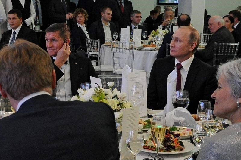 russian president vladimir putin r sits next to retired u s army lieutenant general michael flynn l as they attend an exhibition marking the 10th anniversary of rt russia today television news channel in moscow russia december 10 2015 photo reuters