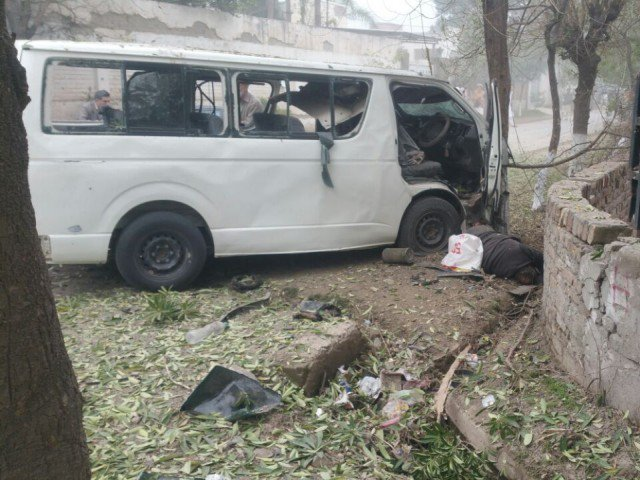 the blast targeted a government van a 5597 while it was on its way to judges colony in the hayatabad peshawar photo iftikhar firdous exprss