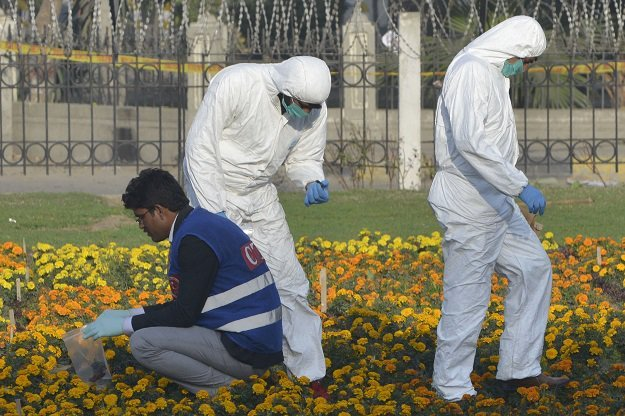 security officials collect evidence at the site of a suicide bombing in lahore on february 14 2017 photo afp