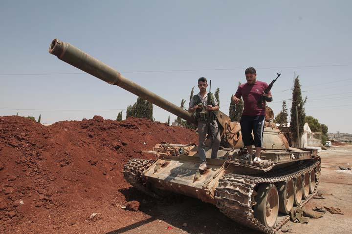 rebel fighters can be seen in syria who are trying to oust the president bashar al assad photo afp