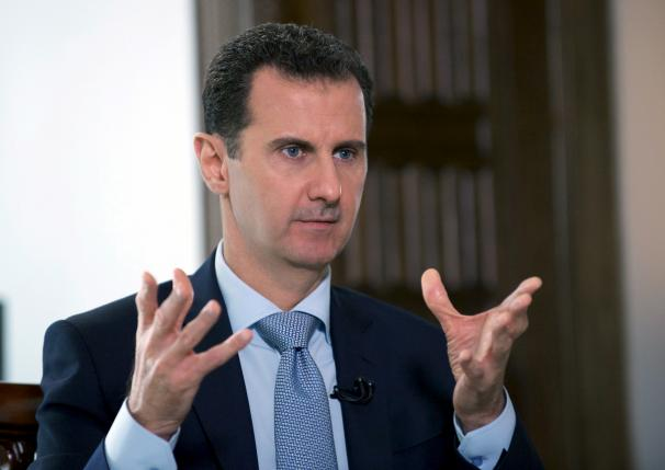 syria s assad says trump travel ban not against syrian people