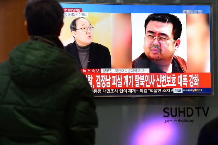 people watch a tv screen broadcasting a news report on the assassination of kim jong nam the older half brother of the north korean leader kim jong un at a railway station in seoul south korea february 14 2017 photo reuters