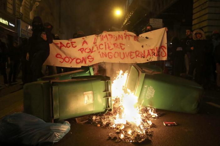 trash burns on the street as people hold a banner that reads quot in face of police impunity lets be ungovernable quot to protest police brutality after a young black man 22 year old youth worker named theo was severly injured during his arrest earlier this month in bobigny as they gather at a demonstration in paris france february 15 2017 photo reuters