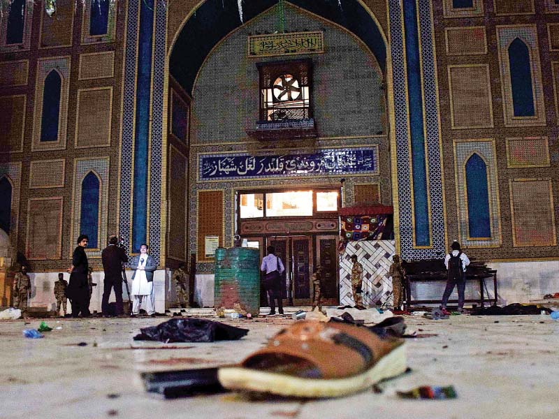Belongings of the victims of the suicide attack lie scattered on the floor of the Sehwan shrine. PHOTO: AFP