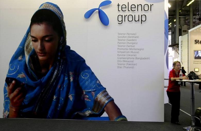 a visitor rests under a telenor group sign at the gsma mobile world conference in barcelona spain february 18 2009 photo reuters