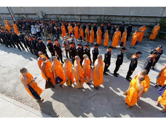policemen and buddhist monks walk inside dhammakaya temple to search for a fugitive buddhist monk in pathum thani province thailand february 17 2017 photo reuters
