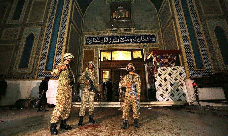 soldiers stand guard outside lal shahbaz qalandar 039 s shrine photo app