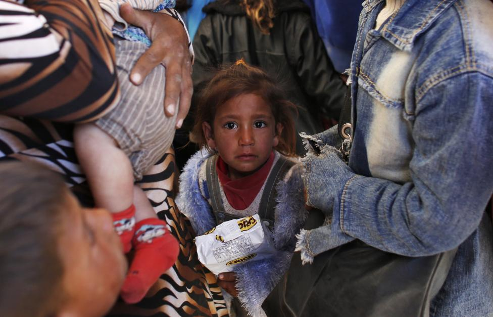 syrian kurdish refugee children wait inside a temporary medical facility after crossing into turkey near the southeastern turkish town of suruc in sanliurfa province photo reuters