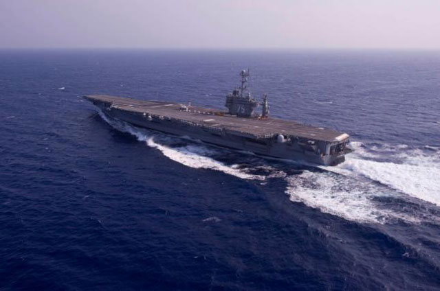 the aircraft carrier uss harry s truman performs a full power run during sea trials in the atlantic ocean in this july 8 2012 handout photo courtesy of the us navy photo reuters