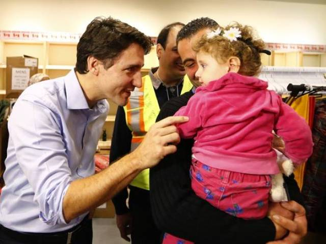 syrian refugees are greeted by canada 039 s prime minister justin trudeau at the toronto pearson international airport in mississauga ontario canada december 11 2015 photo reuters