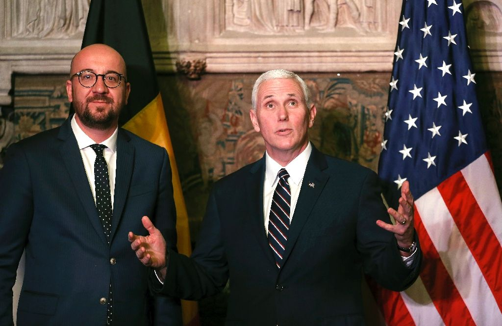 us vice president mike pence r talks to belgian prime minister charles michel at the end of a european tour meeting eu and nato leaders photo afp