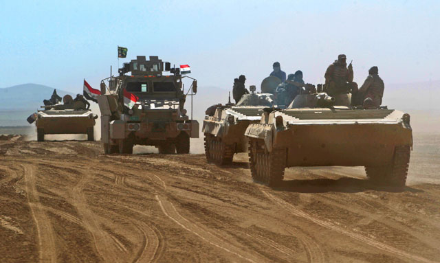 iraqi forces armoured vehicles supported by the hashed al shaabi popular mobilisation paramilitaries advance towards the village of sheikh younis south of mosul after the offensive to retake the western side of the city from islamic state group fighters commenced on february 19 2017 photo afp
