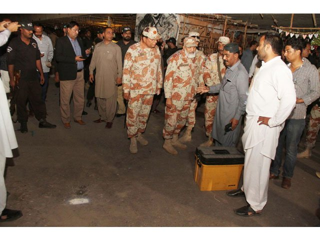 rangers and police personnel inspect the site of cracker explosion at sakhi wahab shah jilani flyover on february 19 2017 photo online