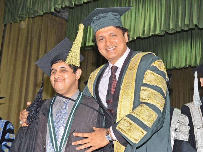 punjab higher education minister syed raza ali gillani awards gold medal to a visually impaired student muhammad ahmad photo abid nawaz express