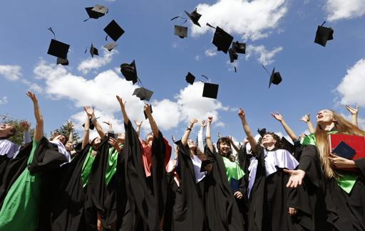 the official photographers have to add the mortarboards in digitally at no extra cost photo reuters