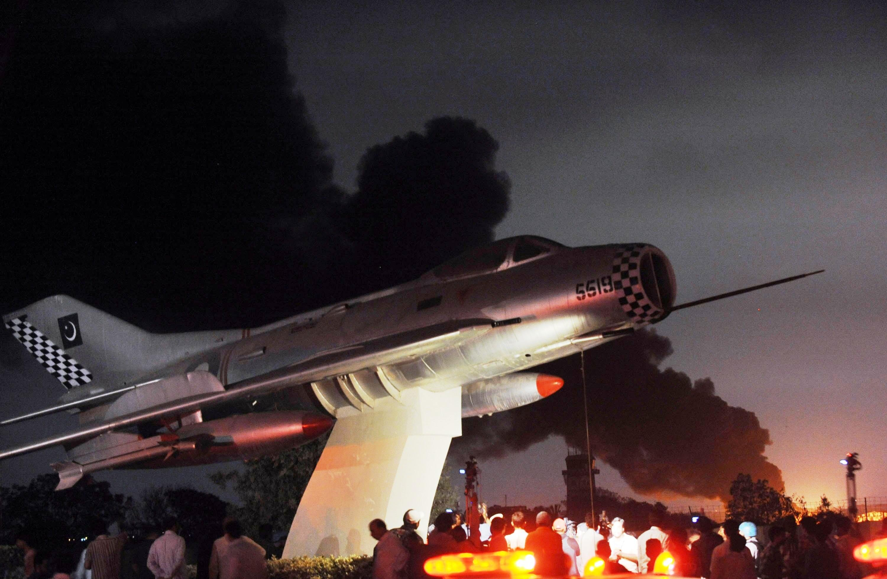 flames and smokes rise from a karachi 039 s naval air base following an attack by militants photo afp