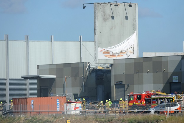 fire crew at the scene where a light plane crashed into the back of a building at essendon airport in melbourne australia february 21 2017 photo reuters