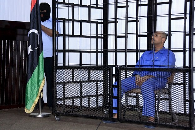 saif al islam gaddafi son of late libyan leader muammar gaddafi attends a hearing behind bars in a courtroom in zintan libya in this may 25 2014 file photo photo reuters