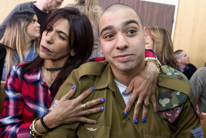 israeli soldier elor azaria is embraced by his mother at the start of is sentencing hearing at a military court in tel aviv israel february 21 2017 photo reuters