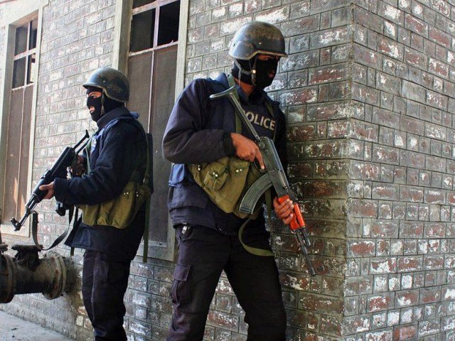 a file photo of khyber pakhtunkhwa police personnel taking part in a raid photo online