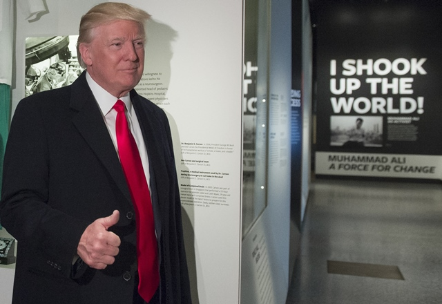 us president donald trump gives a thumbs up as he tours the smithsonian national museum of african american history and culture in washington dc february 21 2017 photo afp