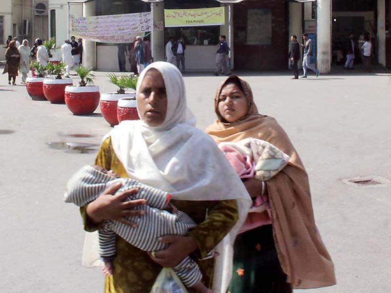 women leave the hospital with their babies after doctors went on strike photo express