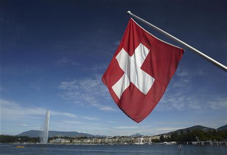 a swiss flag is pictured next to the jet d 039 eau water fountain and the lake leman from the st pierre cathedrale in geneva june 5 2012 photo reuters