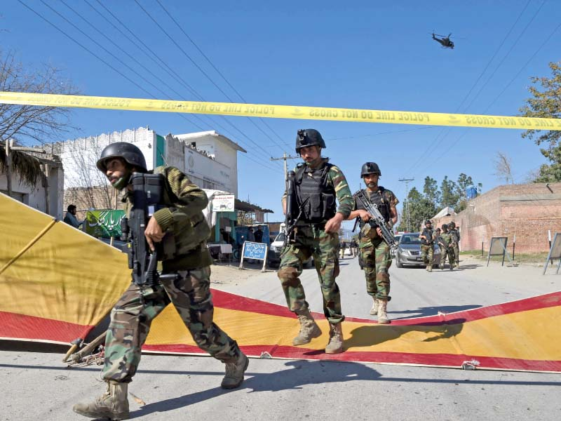 Special forces commandos arrive at the targeted courts complex in Charsadda. PHOTO: AFP