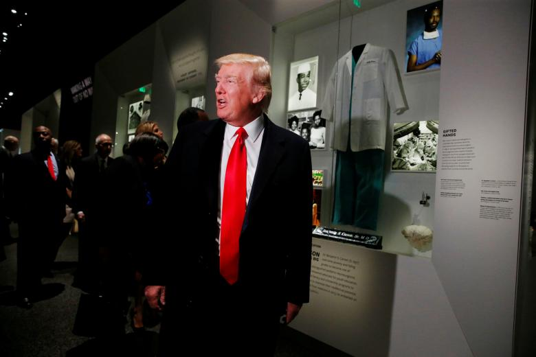 us president donald trump pauses at the dr ben carson exhibit at the national museum of african american history and culture in washington us february 21 2017 photo reuters