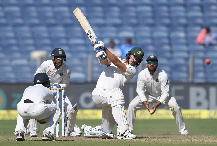 australia 039 s mitchell starc plays a shot as india 039 s ajinkya rahane l wriddhiman saha 2l and murali vijay r look on during the first day of the first test cricket match between india and australia at the maharashtra cricket association stadium in pune on february 23 2017 photo afp
