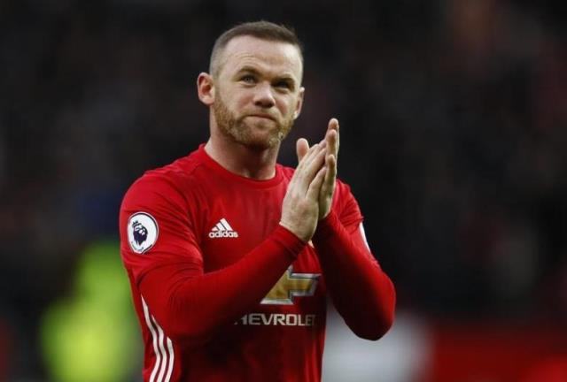 Manchester United's Wayne Rooney applauds the fans. PHOTO: REUTERS