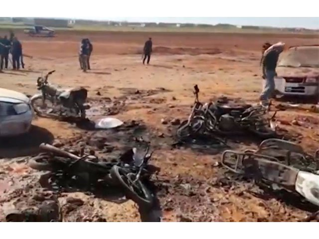 a still image taken from a video posted on social media uploaded on february 24 2017 shows people inspecting the damage at a site of an islamic state car bomb explosion said to be in sousian village near al bab syria photo reuters
