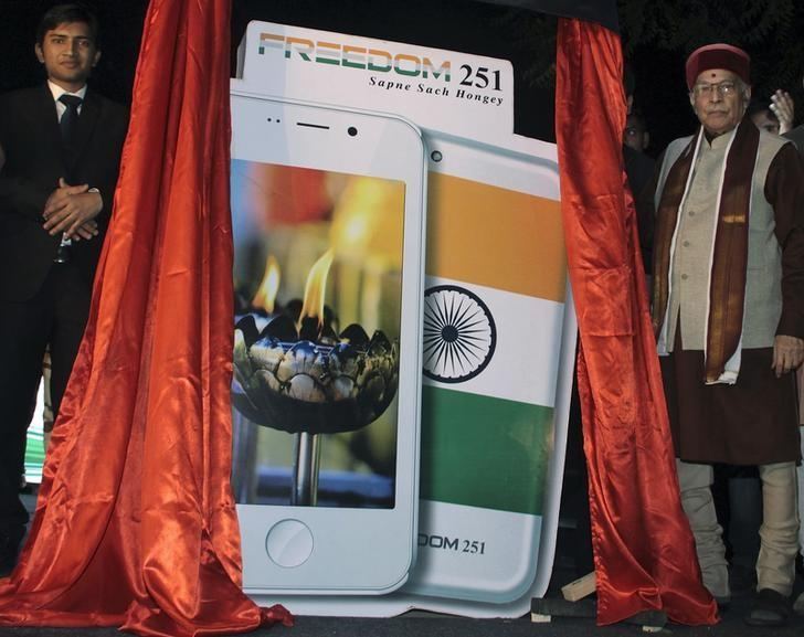 murli manohar joshi r a senior leader of bharatiya janata party bjp poses next to cut outs of freedom 251 mobile phone during its unveiling in new delhi india february 17 2016 photo reuters