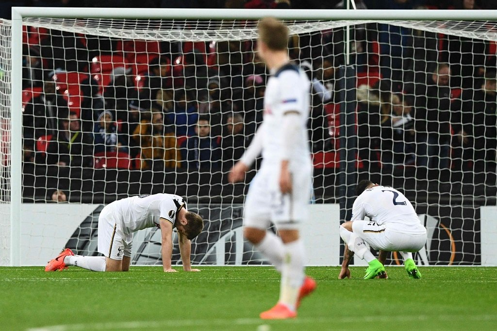 upset pochettino 039 s men slumped to a shock europa league exit as gent 039 s 2 2 draw at wembley gave the unfancied belgians a stunning 3 2 aggregate success in the last 32 second leg photo afp