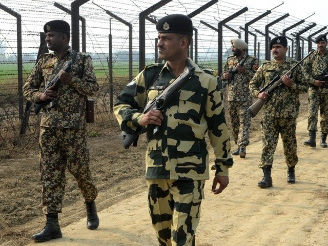 indian border security force soldiers patrol along the india pakistan border fence about 27 km from wagah on january 13 2013 photo afp