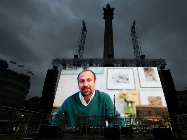 iranian filmmaker asghar farhadi speaks in a recorded video message during the public screening for the film quot the salesman quot in trafalgar square in central london on february 26 2017 afp daniel leal olivas