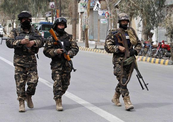 afghan national intelligence officers patrol after an assault by suicide attackers photo reuters