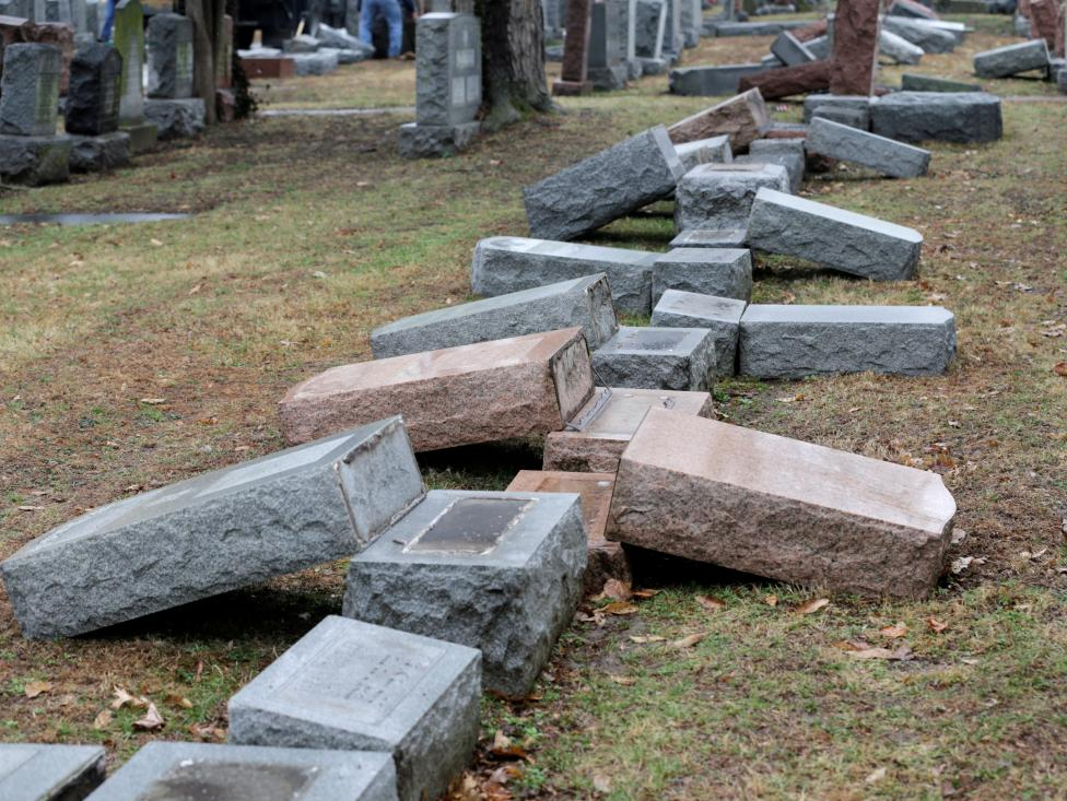 a row of more than 170 toppled jewish headstones is seen after a weekend vandalism attack on chesed shel emeth cemetery in university city a suburb of st louis missouri photo reuters