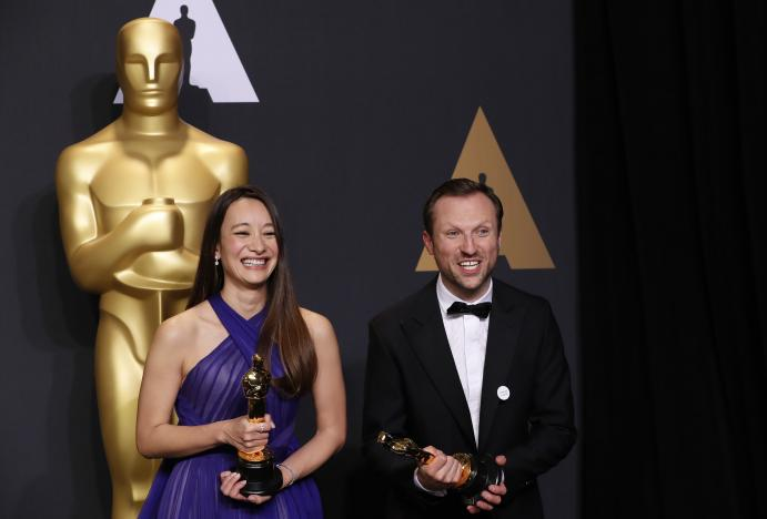 orlando von einsiedel and joanna natasegara hold their oscars for best documentary short subject for quot the white helmets quot photo reuters