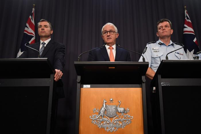 australia 039 s justice minister michael keenan l r prime minister malcolm turnbull and australian federal police commissioner andrew colvin speak during a press conference at parliament house in canberra australia february 28 2017 on a police raid on what they say was a bomb making site in the town of young photo reuters