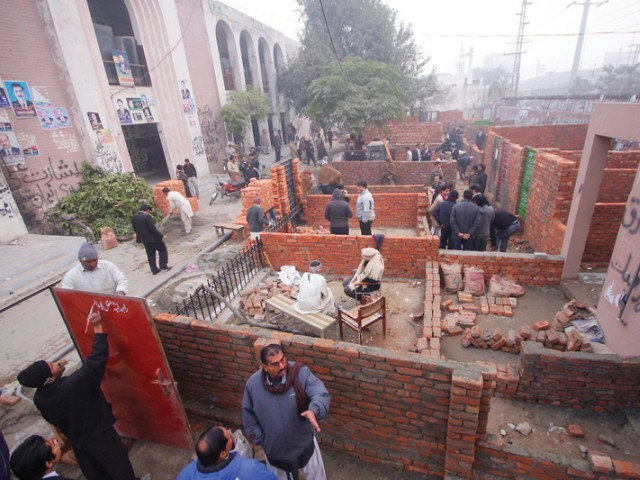 lawyers have built rooms for their chambers in the front lawn of the model town courts photo abid nawaz express