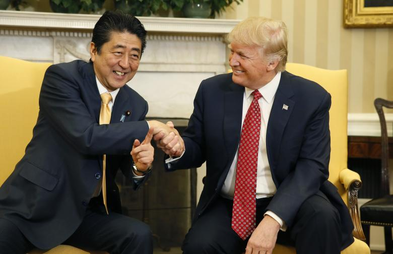 japanese prime minister shinzo abe shakes hands with president donald trump during their meeting in the oval office february 10 2017 photo reuters