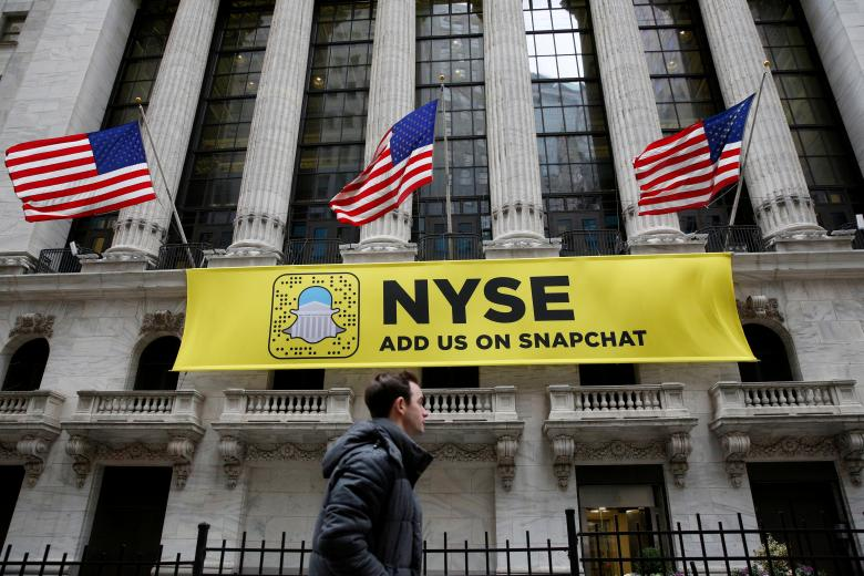A Snapchat sign hangs on the facade of the New York Stock Exchange (NYSE) in New York City, US, January 23, 2017. PHOTO: REUTERS