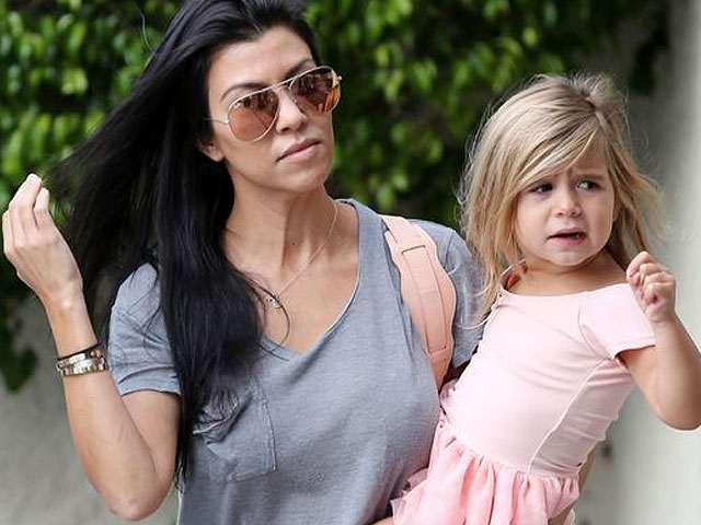 kourtney kardashian called out for letting four year old wear a lip ring