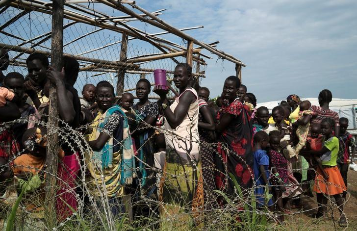 south sudanese women and children queue to receive emergency food at the united nations protection of civilians poc site 3 hosting about 30 000 people displaced during the recent fighting in juba south sudan july 25 2016 reuters adriane ohanesian