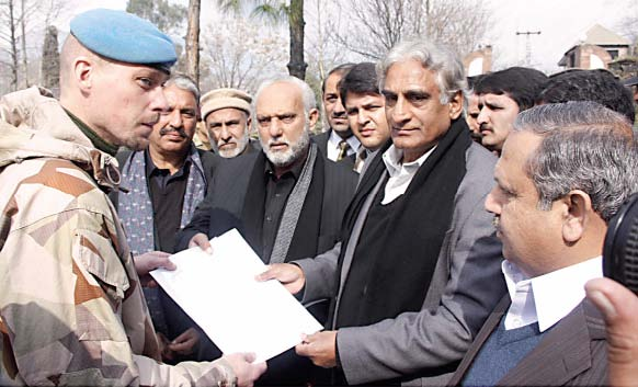 members of the ajk assembly hand over a memorandum of unanimously passed resolutions for the liberation of the people of kashmir to an official of the united nations in muzaffarabad on thursday photo express