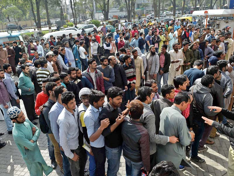 cricket fans queue up to buy tickets for the forthcoming psl final cricket match photo afp