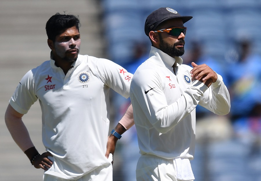 umesh yadav l looks on as captain virat kohli asks for a review of a lbw decision in pune on february 23 2017 photo afp